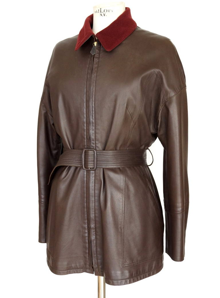 Guaranteed authentic Hermes vintage jacket features deep chocolate brown lambskin leather. The sleeve has five working gold snaps at the cuff.  Awesome! All snaps have HERMES PARIS embossed on them.  The sleeves are sensational as they give the