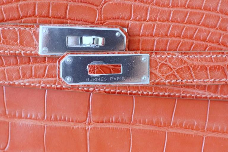 Guaranteed authentic Hermes 35 Retourne Kelly in timeless Sanguine is exquisite in matte alligator.   Fresh palladium hardware.    NEW or NEVER WORN. Comes with shoulder strap, lock, keys, sleepers, raincoat and signature Hermes box. final sale  BAG