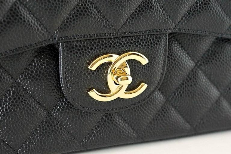 Superb Maxi double flap bag in timeless black caviar.  Impossible to find! Chanel classic with coveted gold hardware. Rear exterior slot pocket.  Signature interior pockets.   Signature CHANEL stamp inside the bag.  Serial number on interior