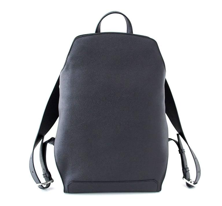 Guaranteed authentic Limited Edition Hermes 27 jet black CityBack gentleman's backpack. Sleek and chic in Epsom Souple with Palladium hardware. The design will be released next year in toile - Not in Leather. Beautifully shaped adjustable straps and