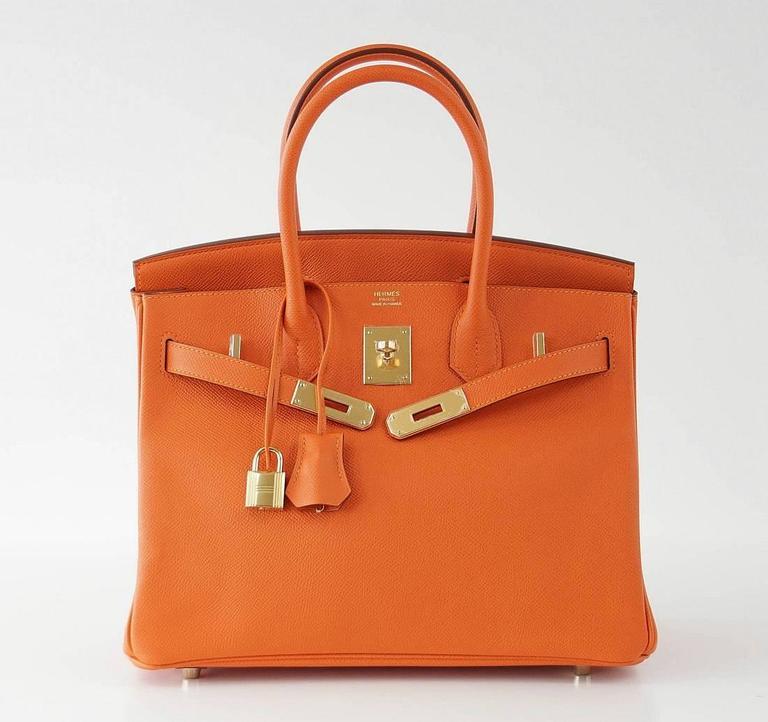 25bddcd5b22 Guaranteed authentic Orange Feu (Fire) Hermes Birkin. Lush with gold  hardware. Epsom