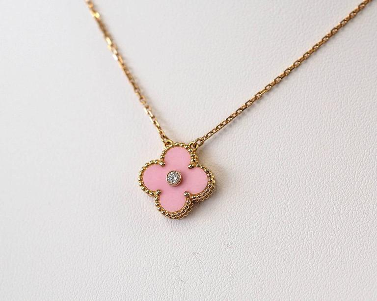 Extremely rare and highly collectible Van Cleef & Arpels Alhambra Collection necklace in pale Pink Sable with round center set diamond. Created for the 2015 Holiday collection and offered only to VIP customers.  No longer produced. Set in 18K Rose