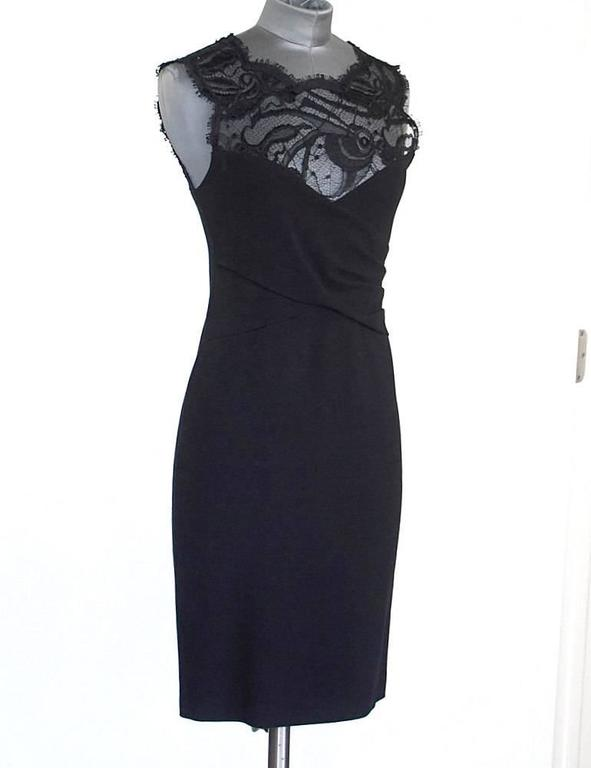 Guaranteed authentic Emilio Pucci black sleeveless dress with beautiful lace inset.  Bodice has figure enhancing criss cross panels. Bold rear zip in gold with embossed pull. The perfect LBD from dinner to cocktail party. Fabric is viscose, nylon