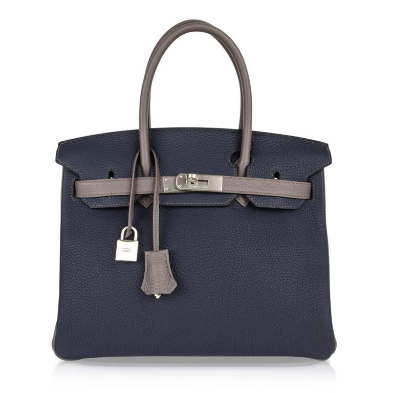 Guaranteed authentic Hermes Birkin HSS 30 bag featured in understated elegance of Blue Nuit and Etain. Rare brushed Palladium hardware completes this beautiful special order chic bag. Togo leather. NEW or NEVER WORN.  Plastic is not on the hardware.