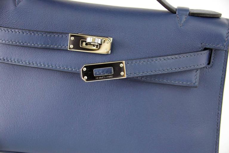 Guaranteed authentic HERMES beautiful Bleu de Prusse in Swift Leather. So chic with Palladium hardware. This treasure is easily carried day or night, casual to dressy.   Signature stamp on interior. Small interior compartment. Comes with sleeper and