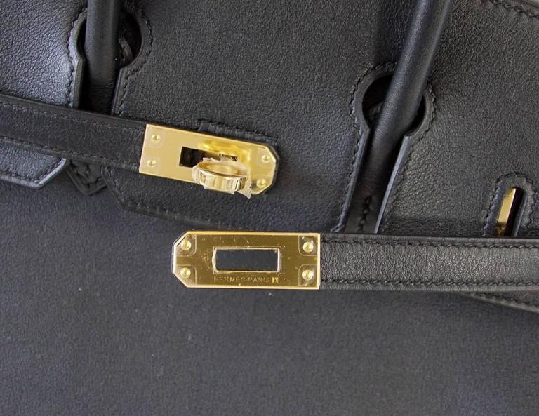 111564289e4 Guaranteed authentic chic and elegant Black swift leather HERMES BIRKIN 25  bag. Lush with Gold