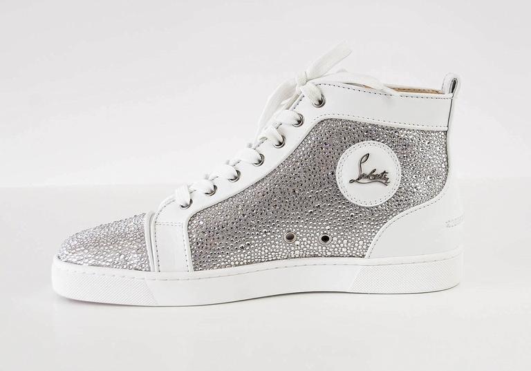 58556fc4aad3c Guaranteed authentic CHRISTIAN LOUBOUTIN striking Louis Flat Diamante  sneaker. Coveted White diamante encrusted sneaker.