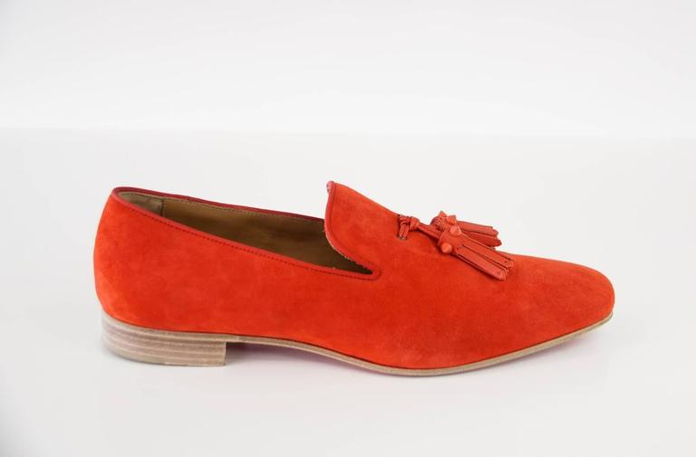Guaranteed authentic Christian Louboutin very beautiful red suede loafer.  Men's soft toned red loafer with leather tassles. Tassels are accentuated with signature red spikes. Comes with box and sleeper. final sale  SIZE 42 USA SIZE