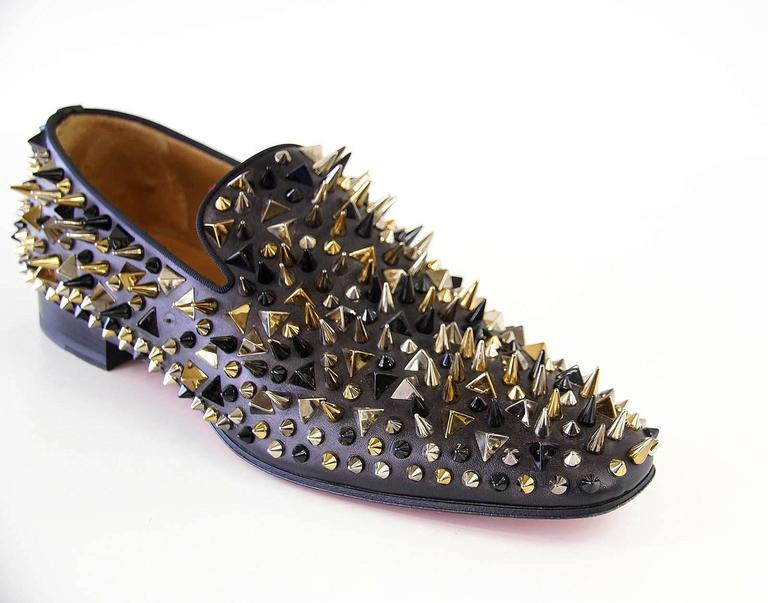 Guaranteed authentic Christian Louboutin  striking and bold Dandy Pik Pik loafer.  Black silver and gold various sized Pik Pik loafer on black calf. Uppers are like new. Comes with box and sleeper. final sale  SIZE 44.5 USA SIZE