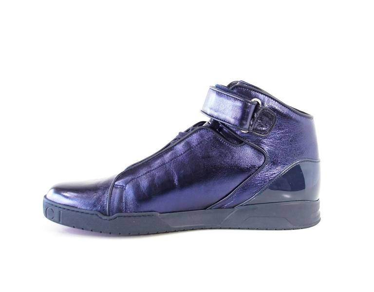 Guaranteed authentic GUCCI men's Midnight Blue Nappa Silk leather high-top sneaker. Rich jewel toned blue lace up with side guard panels. Rear is accentuated with patent leather. Velcro grip ankle straps. GUCCI is stamped around front of shoe. Comes