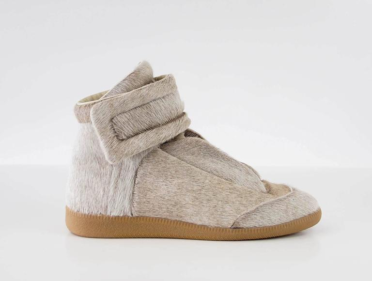 Guaranteed authentic MAISON MARTIN MARGIELA men's high top sneaker in sanded grey pony. Lace up front with lace guards on the sides. Velcro closure grip straps around ankle. Comes with signature box. NEW or NEVER WORN.  final sale  SIZE  43 USA SIZE