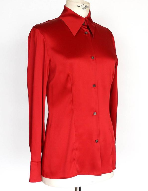Guaranteed authentic GIANFRANCO FERRE beautiful red blouse.  Beautiful and timeless Chinese red blouse. 7 small square buttons with 2 buttons at the collar. Stitching detail gently shapes this blouse in front and back. 2 buttons on each cuff. Fabric