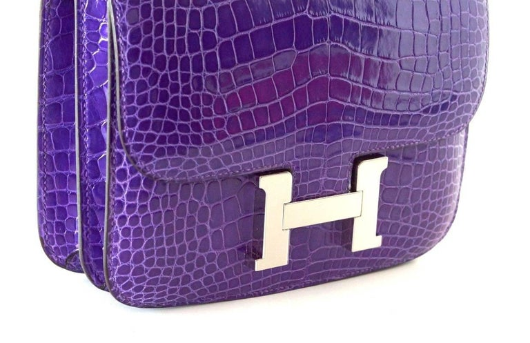 Guaranteed authentic coveted and rare 18 cm Constance in jewel toned Ultra Violet with palladium hardware. Carried by hand, over the shoulder, or even across the body! HERMES PARIS MADE IN FRANCE is stamped on front under flap. NEW or NEVER