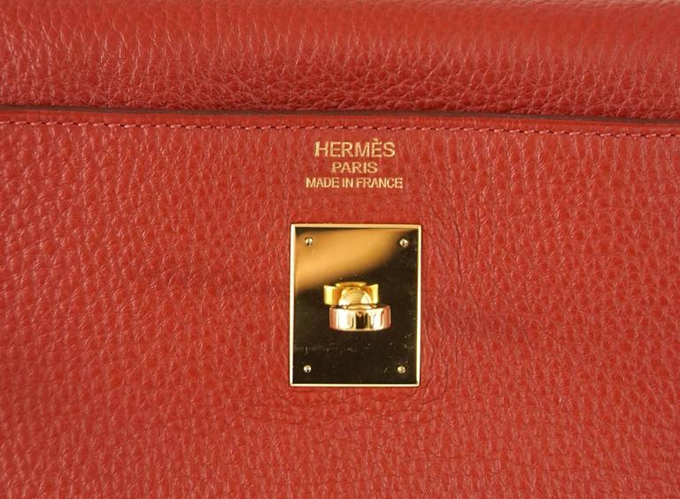 Guaranteed authentic rich Rouge Garrance Kelly 40 togo leather with Gold hardware. Clean corners, handle, body and interior. Comes with lock, keys, sleeper for bag, shoulder strap and Signature Hermes box.   final sale  BAG MEASURES: LENGTH  40 cm /