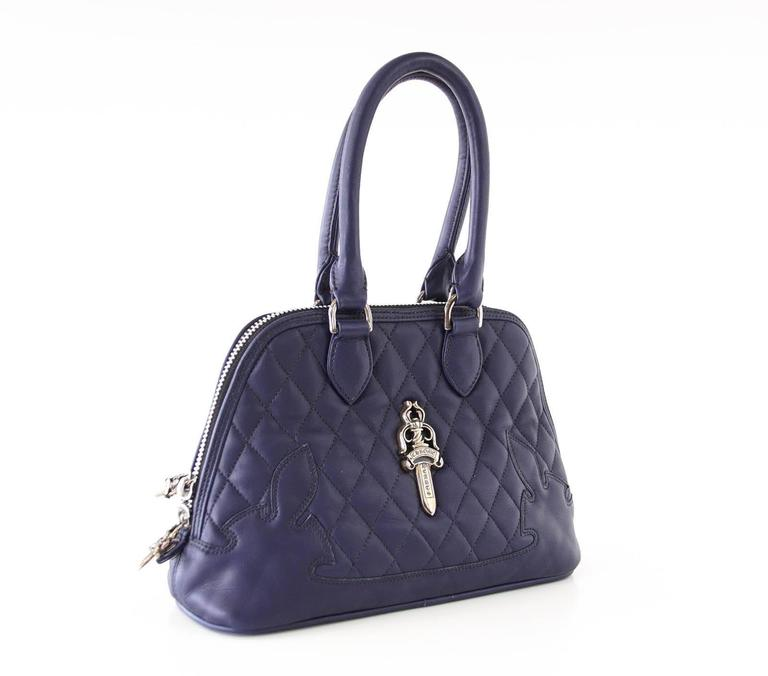 Guaranteed authentic Navy quilted Chrome Hearts charming bag with stitched logo at corners. Signature Silver logo plaque in front and rear embossed name. Top zip with logo pull. All hardware is sterling silver. Top rounded leather handles. Interior