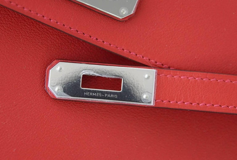 Guaranteed authentic timeless Hermes Kelly Cut  clutch bag featured in rich warm Vermillion red. Swift leather. Fresh with palladium hardware.  Comes with sleeper, signature Hermes box and ribbon.     NEW or  NEVER WORN.  final sale  BAG