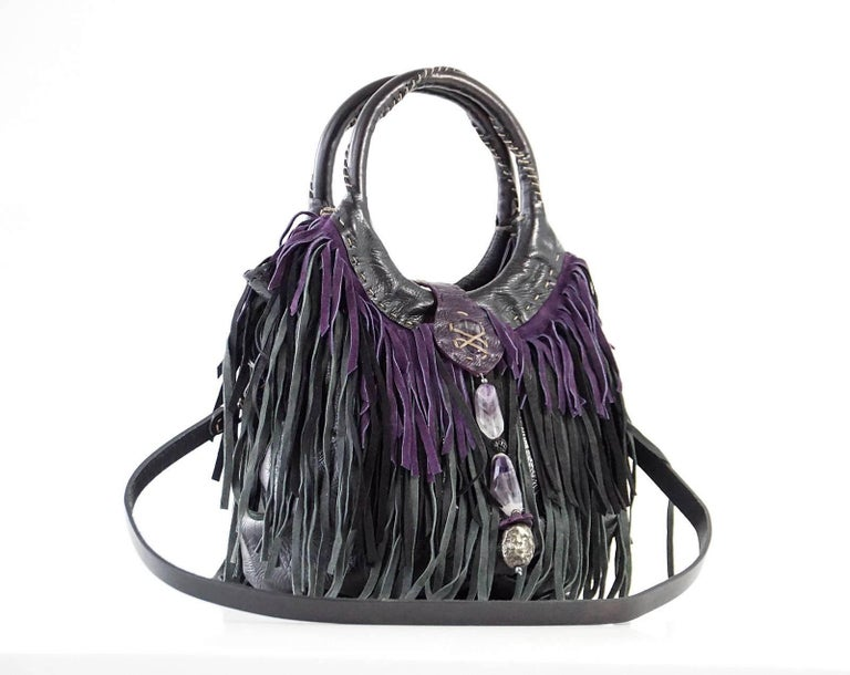 Guaranteed authentic HENRY BEGUELIN handmade fringe Folies Bijoux shoulder / handbag with detachable strap. 3 layers of suede fringe in plum, charcoal and black. Body is leather with beautiful stitch detail. Round handles with signature top stitch