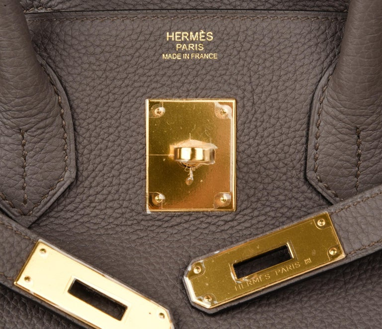 Guaranteed authentic Hermes Birkin 30 bag featured in coveted Etain Gray with lush gold hardware.  Neutral perfection in togo leather. NEW or NEVER WORN Comes with the lock and keys in the clochette, sleepers, raincoat and signature Hermes box.