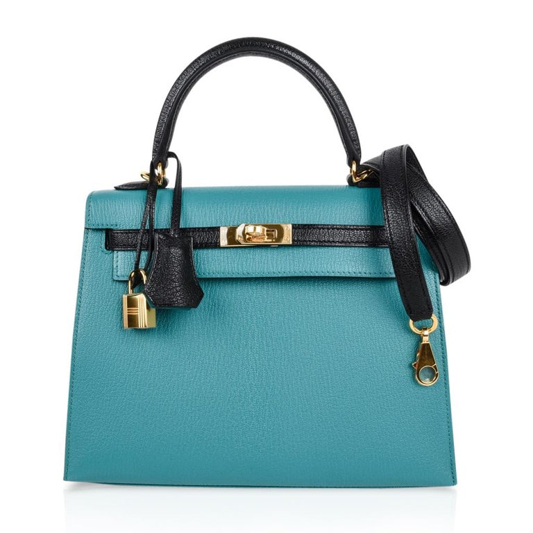 Guaranteed authentic exquisite Hermes Kelly HSS Sellier 25 bag in exotic Blue Paon and Black. This speical order Kelly bag is created in coveted Chevre Mysore leather. Lush with Gold hardware.   Comes with signature Hermes box, raincoat, shoulder