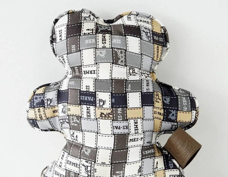 Guaranteed authentic charming HERMES Bolduc silk Dou Dou teddy bear. In shades of taupe, grey, camel, white and creme.  final sale  SIZE OF TEDDY BEAR: LENGTH  6
