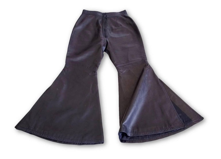 Guaranteed authentic GIANNI VERSACE ATELIER dramatic Vintage black lambskin leather pant. Flat front style with front zip and 1 black button. Bold bell bottom styling with 12