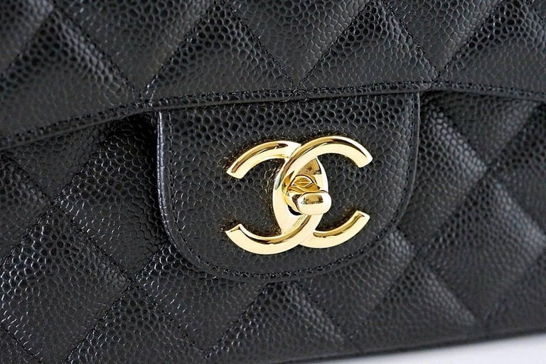 Guaranteed authentic superb Maxi double flap bag in timeless black caviar.  Chanel classic with coveted gold hardware. Impossible to find this coveted beauty. Rear exterior slot pocket. Signature interior pockets.  Signature CHANEL stamp inside the