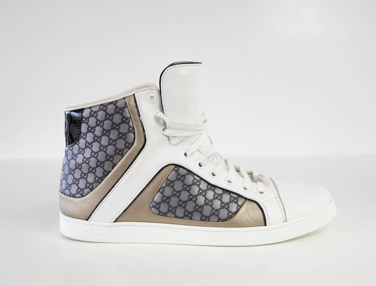 08768092b Guaranteed authentic Gucci men's white leather high top sneaker with  embossed grey monogram and gold trim