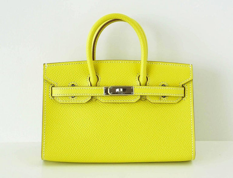Guaranteed authentic Hermes Tiny Miniature Birkin Limited Edition. Lime Epsom leather with palladium hardware. Worn as wristlet, shoulder bag, top handle or draped on on larger sized bag. Comes with detachable shoulder strap, sleepers and signature