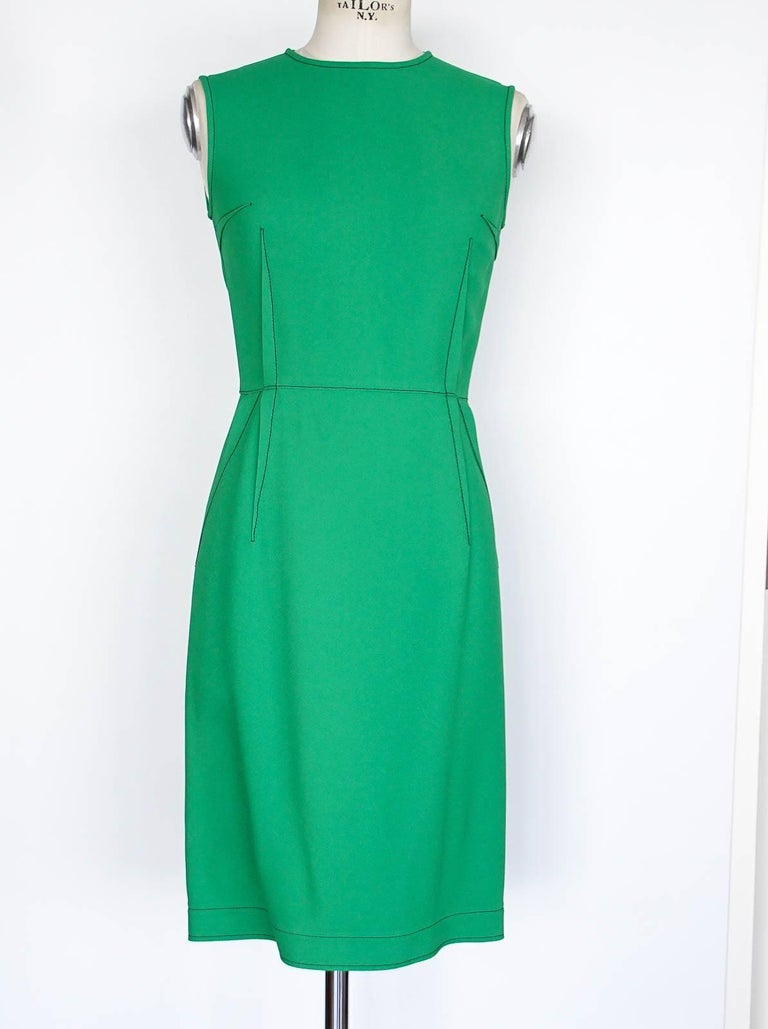 Guaranteed authentic Lanvin beautifully cut kelly green dress with stitch detail.  A versatile work/luncheon dress. The shaping is accentuated by the details stitch 'darts' for a flattering fit. Double toggle bold rear zip. Fabric is