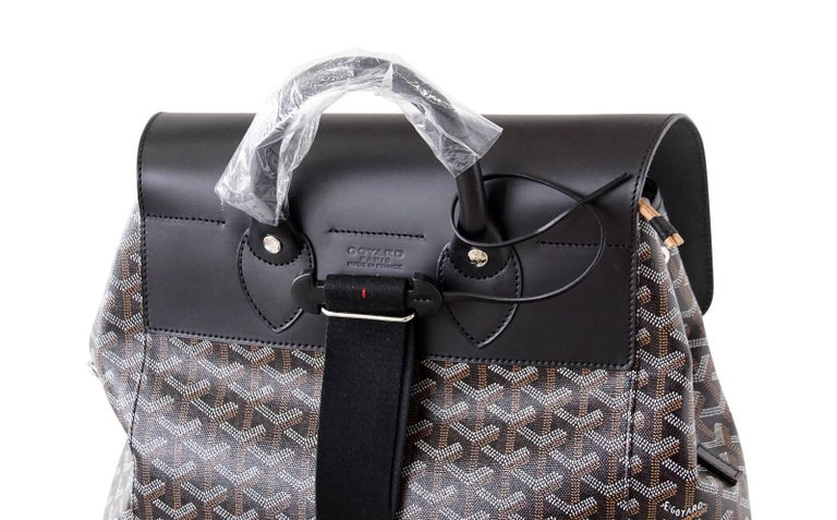 Guaranteed authentic Goyard Black signature chevron print and calfskin leather coveted Alpin backpack.  Shoulder straps are adjustable to use as shoulder bag. Under front flap drawstring closure opens to roomy interior with patch pocket