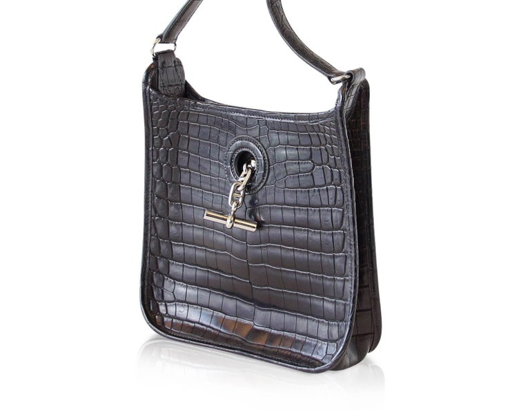 Rare Hermes TPM Vespa in jet black matte crocodile. Iconic palladium Chaine d'Ancre toggle for closure.  Rare to find in crocodile this beauty will set you apart from the TPM Evelyne and will surely become your 'go to' cross body!  Timeless and an