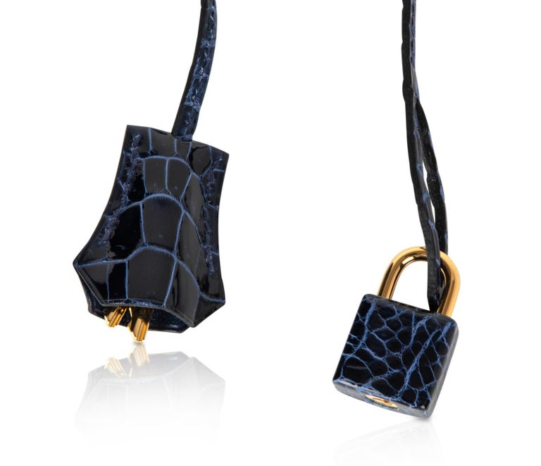 Guaranteed authentic jewel toned Hermes Birkin 35 bag featured in Blue Sapphire Porosus Crocodile.  This Hermes Birkin is not unlike a faceted sapphire.  A gorgeous jewel. Lush with Gold hardware. Comes with lock and keys in the clochette, sleepers
