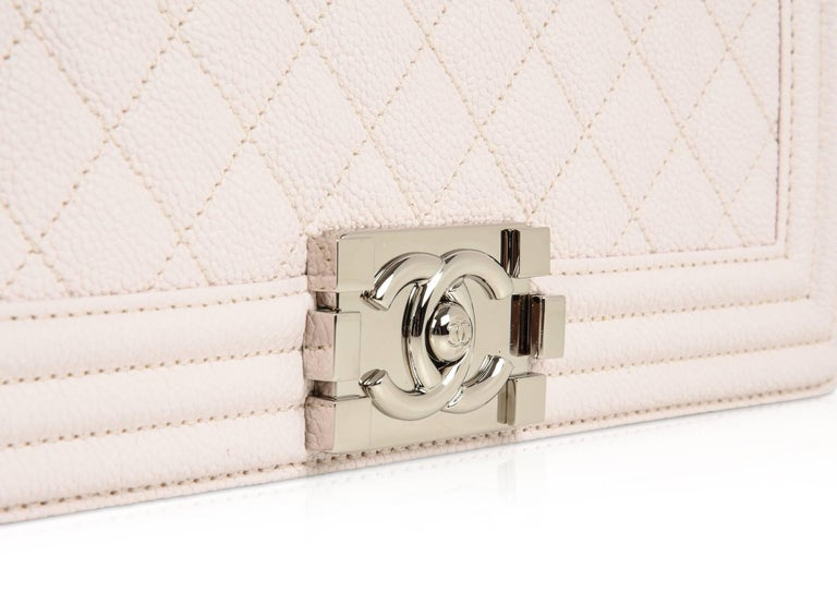 Guaranteed authentic Chanel Old Medium Boy bag in whisper White  Nude quilted caviar leather. Classic with full front flap. Signature CC push lock.  Padded shoulder strap and silver rich chain link. Worn as either a shoulder bag or cross body bag.