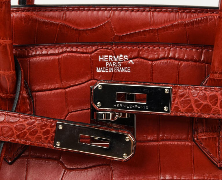 Guaranteed authentic rare Hermes Birkin 40 bag. Coveted Matte red Porosus Crocodile birkin with fresh palladium hardware. Extremely light wear marks on corners. Light marking on hardware. Clean handles and body. Clean interior. Comes with lock,