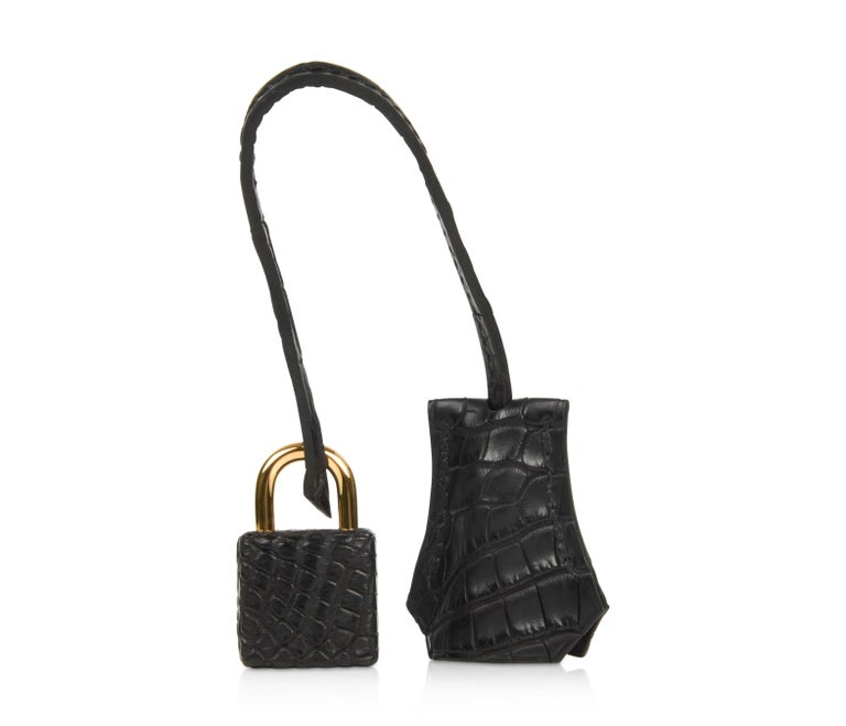 Rich with gold hardware this beautiful black alligator bag is chic day to evening. Comes with lock, keys, clochette, sleepers, raincoat and signature Hermes orange box. NEW or NEVER WORN The Hermes Birkin 25cm price maintains its value due to the