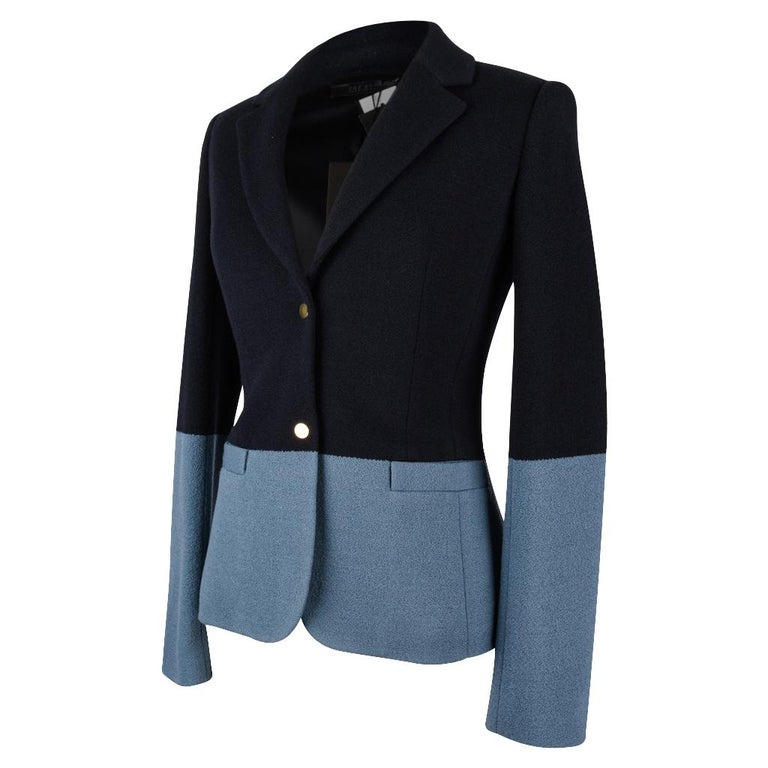 Guaranteed authentic The Row beautifully shaped navy and slate blue colour block jacket. 2 gold toned snap buttons.  2 flap pockets. No buttons on cuffs. Fabric wool and acrylic. NEW or NEVER WORN.  Tags attached. final sale  SIZE 4 USA SIZE 6 /