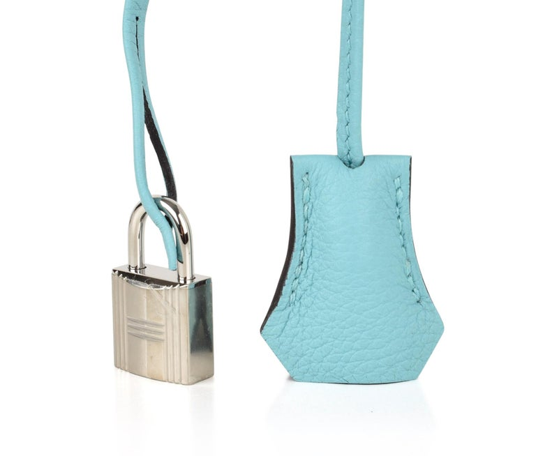 Guaranteed authentic Hermes Kelly 28 bag featured in cool beautiful Blue Atoll. Togo Leather.  Palladium hardware. Divine size for day to evening.  NEW or NEVER WORN. Comes with signature Hermes box, raincoat, shoulder strap, sleepers, lock, keys