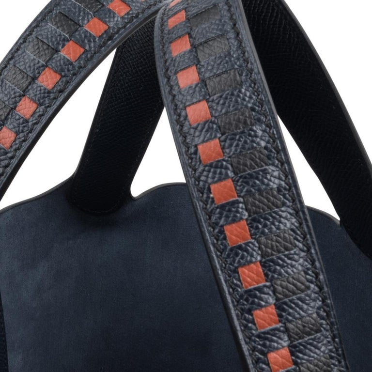 Guaranteed authentic limited edition Hermes Picotin Lock 18 Tressage De Cuir PM bag features Blue Indigo/Black/Terre Battue. Fresh Epsom leather and palladium hardware. Rare to find with gold hardware. Comes with lock and keys, sleeper, and