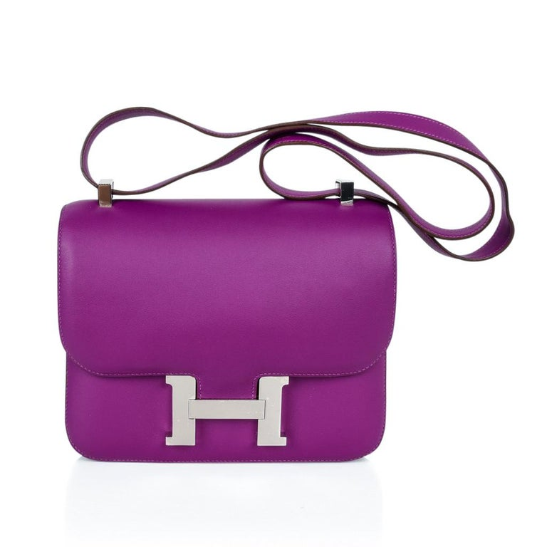 Guaranteed authentic coveted 24 Hermes Constance in jewel toned Anemone with palladium hardware. Carried by hand, over the shoulder, or even across the body! HERMES PARIS MADE IN FRANCE is stamped on front under flap. NEW or NEVER WORN. Comes with