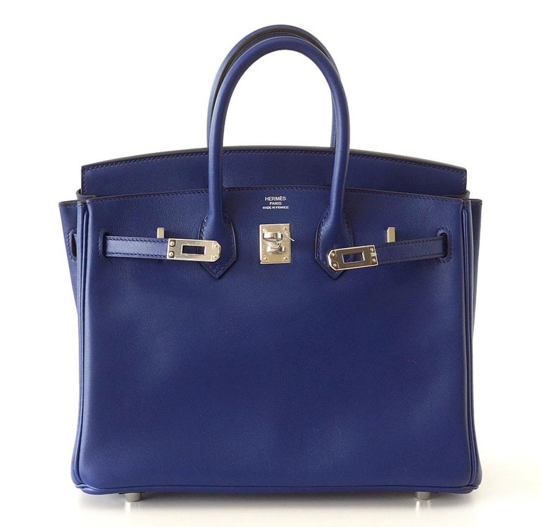 Guaranteed authentic Hermes Birkin Bleu Saphir (Blue Sapphire) Like wearing a magnificent sapphire stone with fresh Palladium hardware. Lush swift leather. Comes with lock, keys, clochette, sleepers, raincoat and signature Hermes box. NEW or NEVER