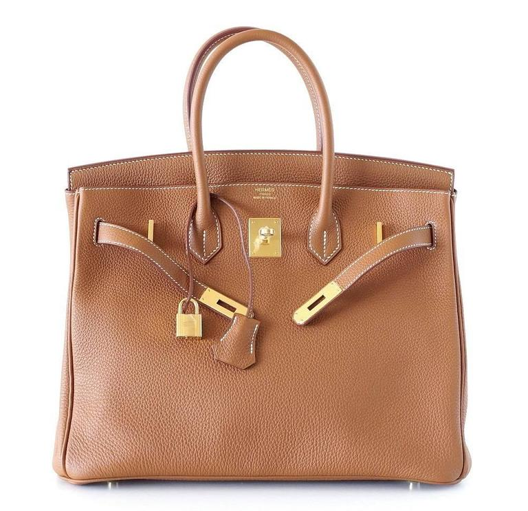 "Guaranteed authentic Hermes 35 Birkin Iconic Classic. Coveted iconic Gold togo with lush gold hardware. NEW or  NEVER WORN.  Comes with sleepers, lock, keys, raincoat and signature Hermes box.  final sale  BAG MEASURES: LENGTH  35cm / 14"" TALL"