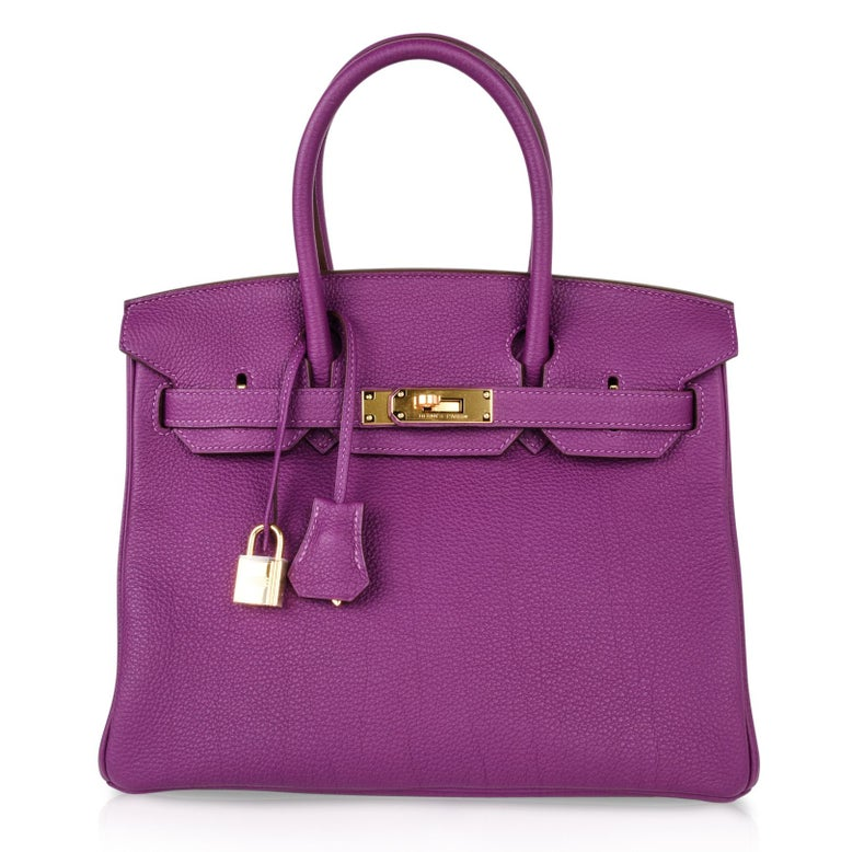 Guaranteed authentic Hermes Birkin 30 luxurious Anemone retired colour purple. Togo leather with gold hardware. This exquisite pre owned bag has immaculate corners, body, handles and interior. Brand new strap gold hardware.   Lock is still in