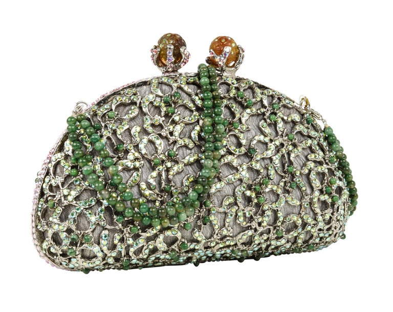 Exquisite hand-made evening purse encrusted with approximately 2000 crystals evening bag. Jade beading set on wiring. Beaded jade double strand handle is removable adding versatility to this clutch / handbag. Lined in finely textured pewter