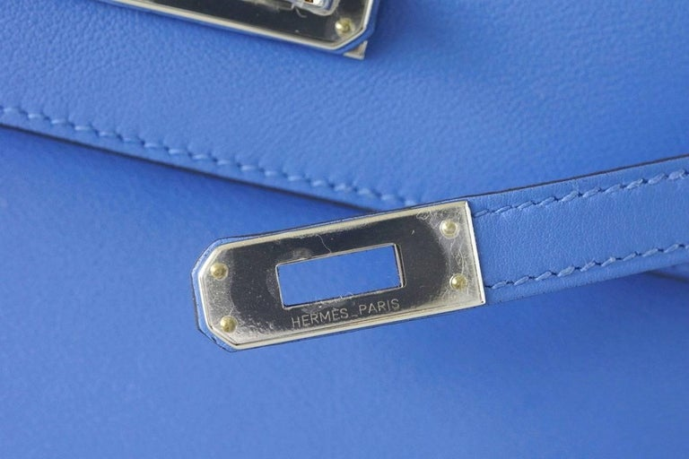 Guaranteed authentic Hermes Kelly Pochette Blue Paradise is an exquisite year round color. Fresh with Palladium hardware. This treasure can be carried day or night.  Stamped HERMES MADE IN PARIS on the interior. Small interior compartment. Comes