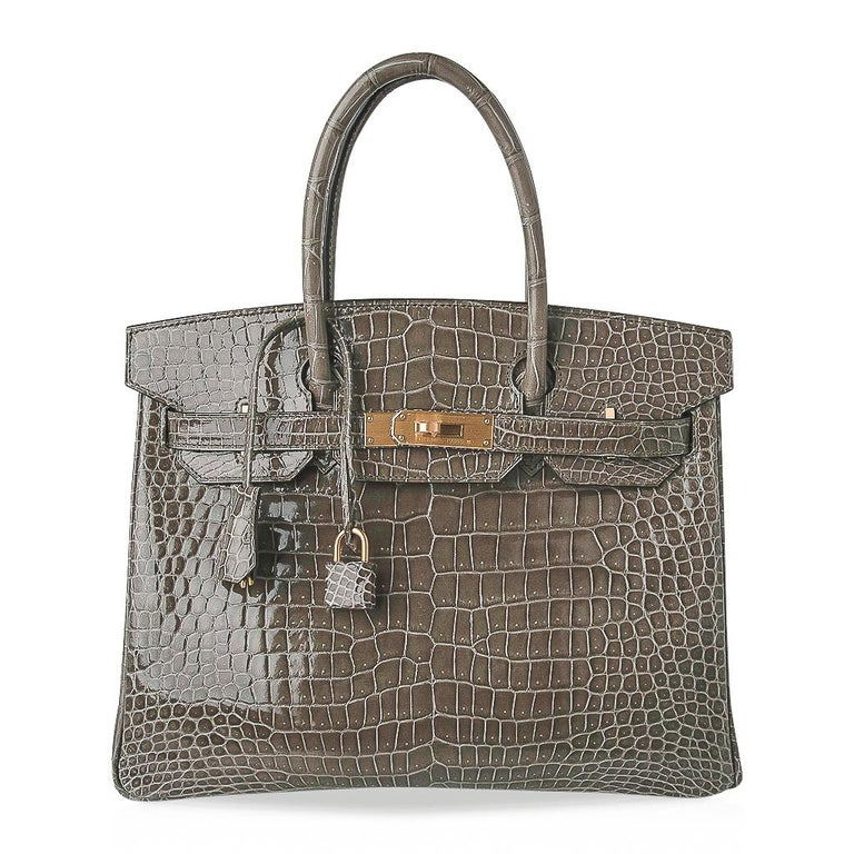 Guaranteed authentic Hermes Birkin 30 special order HSS featured in limited edition coveted Gris Tourterelle. Porosus crocodile creates this rare beautiful colour is perfect for year round wear. Accentuated with brushed gold hardware. Rich jewel