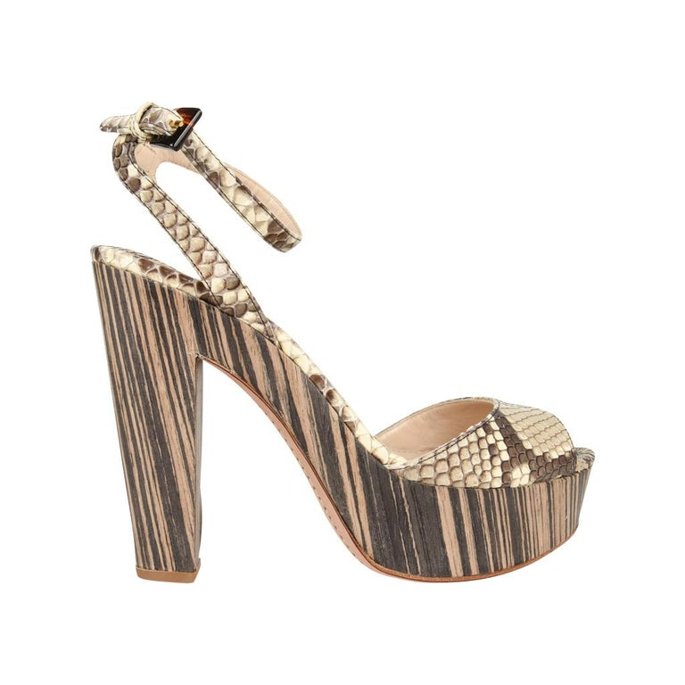 Guaranteed authentic fabulous Prada snake sandal with unique bold platform. Taupe brown to off white snake skin open toe ankle strap.  Fabulous two tone high wood platform heel.  Sexy and versatile.   Comes with box and sleeper.  NEW or  NEVER WORN.