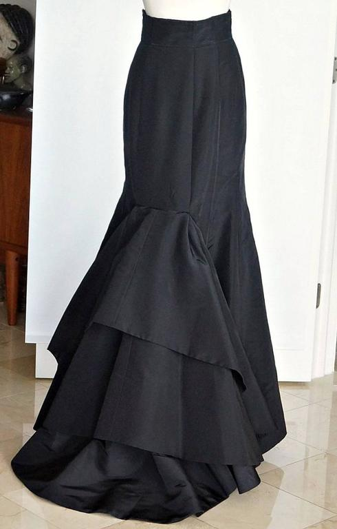Guaranteed authentic OSCAR de la RENTA exquisite formal black silk taffeta floor length skirt.   Superb cut from the front that is accentuated with the exquisite large ruffled rear. Sublime fit. This piece works from Sharon Stones' white shirt to