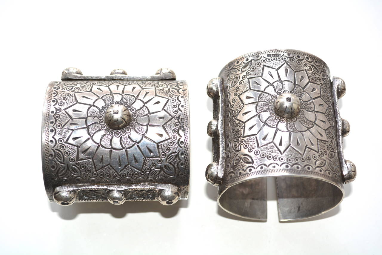 Exceptional vintage silver Egyptian signed large cuffs with slits that flex over the hand, a bit, to allow one to slip them on.  The first mark seems to read: 900 Silver content, maybe a flower hallmark? Hard to read. Could be by famous Bedouin