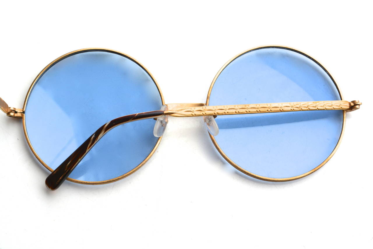 Vintage glass lens mid to late 60s, early 70s metal frame sunglasses.  Similar to those worn by Janis Joplin. Great larger frame and lens.  The size isn't small or tight, but more of a medium to larger normal fit. Amazing condition with just one