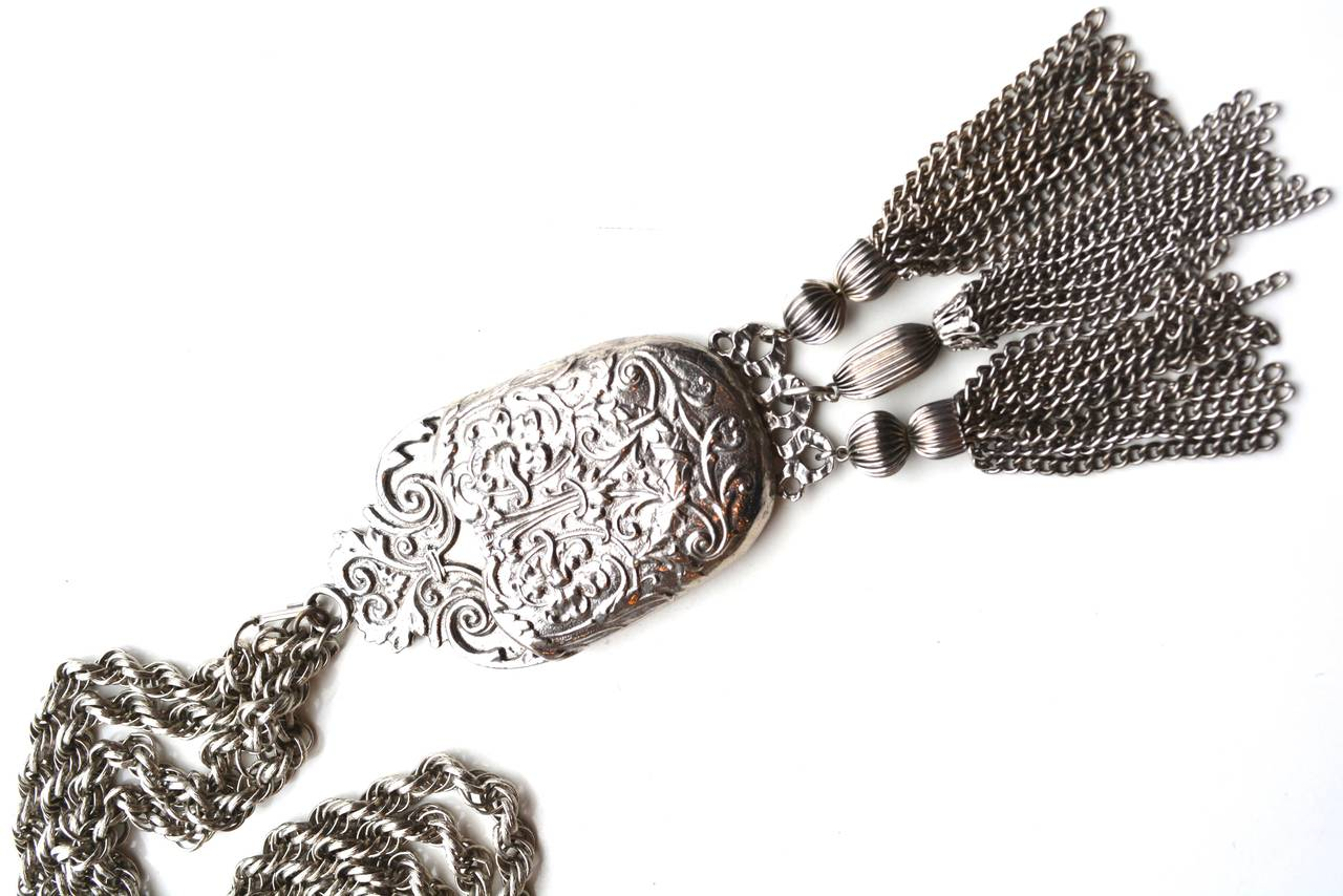 Signed designer silver tone metal Pauline Rader belt with a lovely larger scale Victorian revival tassel pendant. The piece can easily be worn as a necklace as well and lays flat with a simple hook clasp. Can be wrapped or worn longer. Main pendant